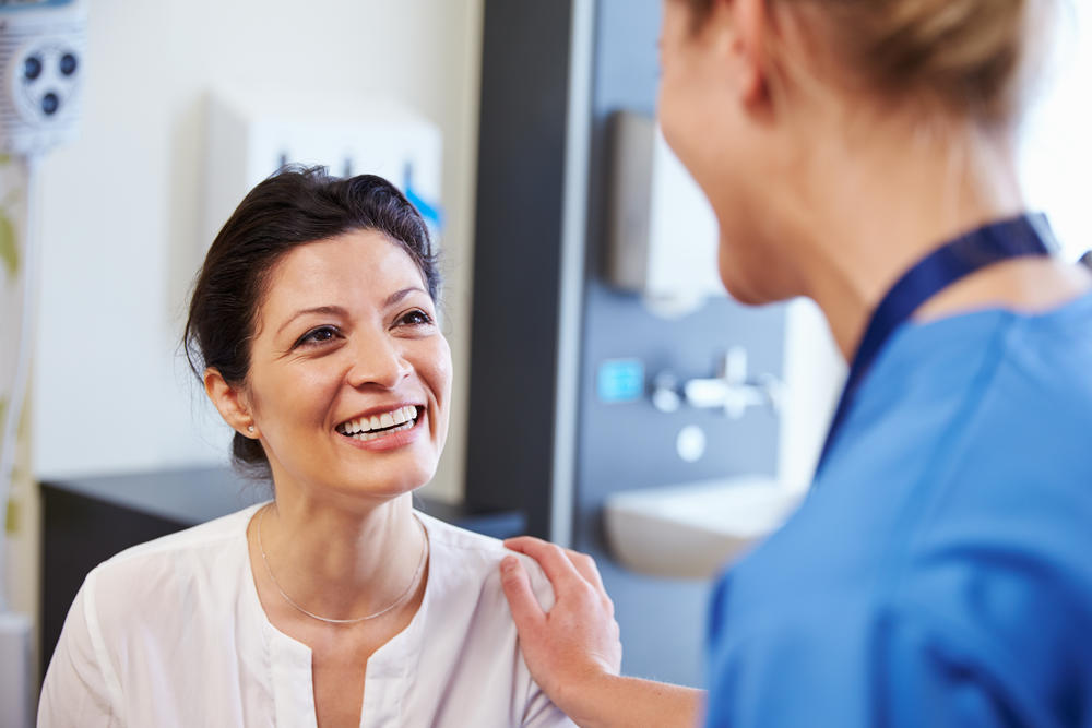 Female patient being reassured by a doctor at a walk-in clinic